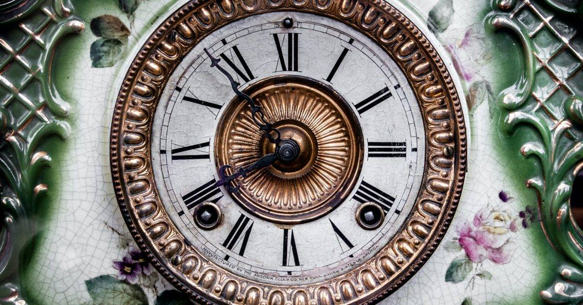 round gold-colored analog clock