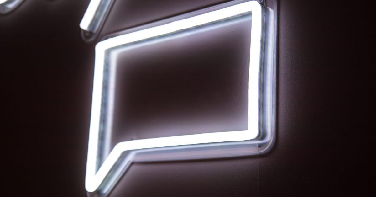 white neon light signage on wall