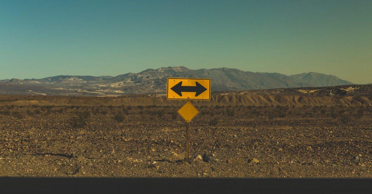 yellow arrow road sign