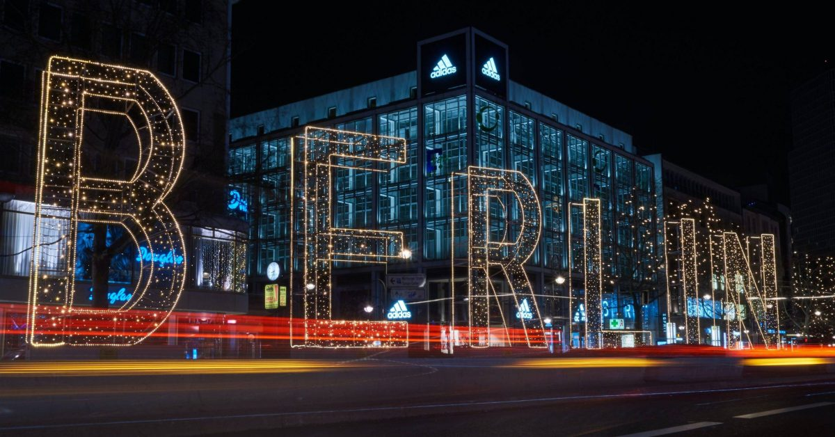 Berlin lighted free standing signage during night time