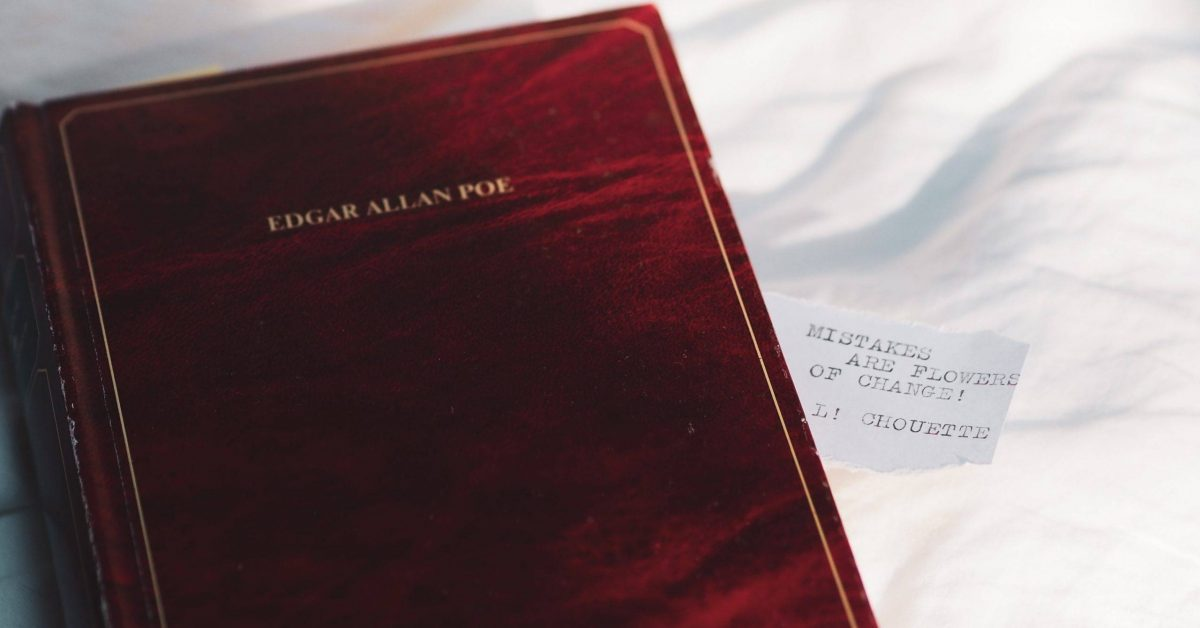 red book on white textile