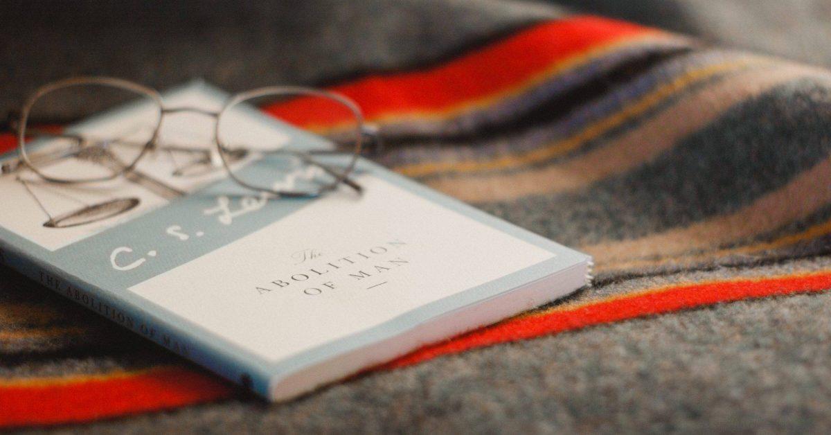 gray framed eyeglasses on book