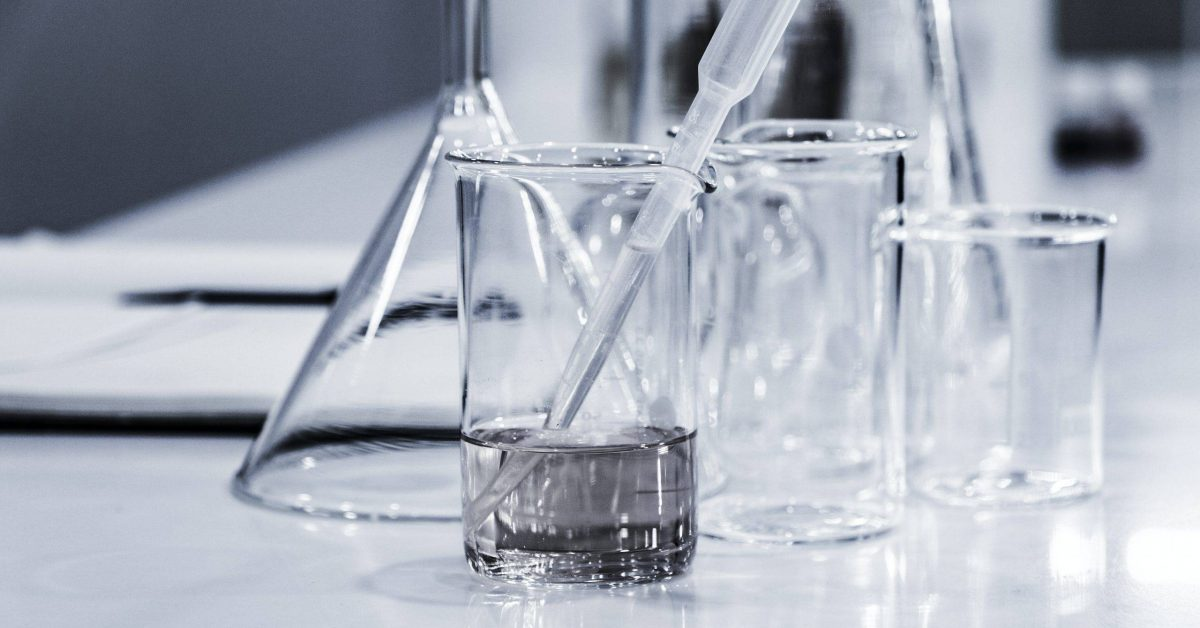 three clear beakers placed on tabletop