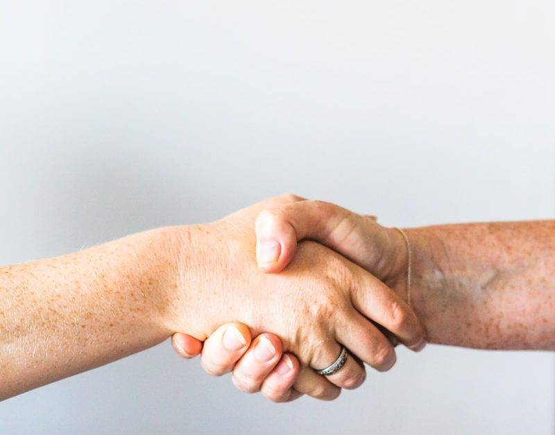 person holding hands of another person
